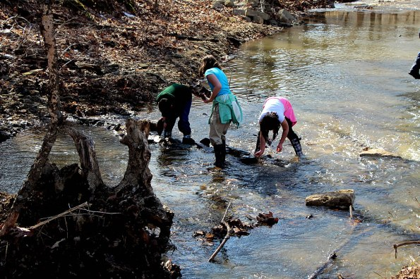 Building a spillway in the creek at LM Sugarbush
